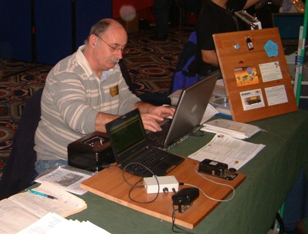 Photograph of the Morse decoding exhibit and John M0CDL working on his laptop at the NARSA Norbreck Rally in April 2010