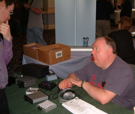 Photograph of Paul M0BMN discussing his QRP (low power) CW transceivers with a visitor at the NARSA Norbreck Rally in April 2010