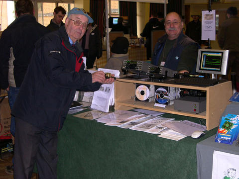 Photograph of Wythall 2006 Rally FISTS stand showing Stan G0BYA and John M0CDL.